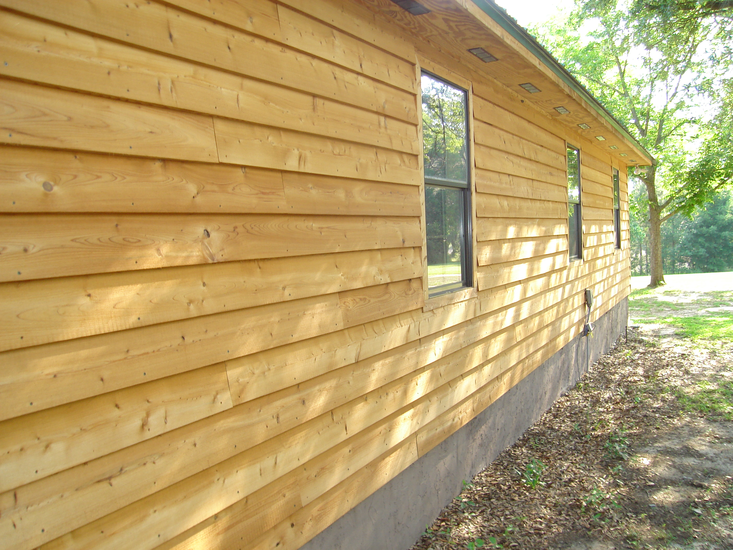 Wood siding siding replacement company for Types of wood siding for homes